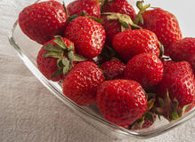 Red strawberries on old wood table Stock Photo