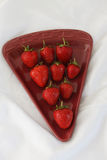 Red strawberries. On the plate Royalty Free Stock Photography