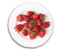 Red strawberries in plate. Red and succulent strawberries in a plate, isolated in a white background Stock Photos