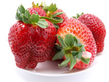 Red strawberries on plate. Red strawberries on white plate Stock Photography