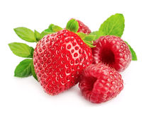 Red strawberries and raspberries. Fresh red strawberries and raspberries on the white stock photo