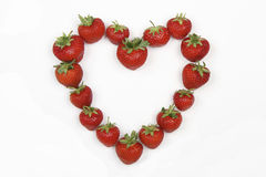 Red Strawberries in the shape of a love heart Stock Photography