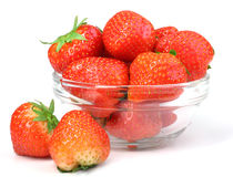 Red strawberries in transparent plate on white Stock Photography