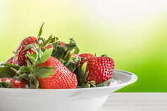 Red strawberries on a white plate Royalty Free Stock Image