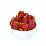 Red strawberries in a white saucer isolated on white Stock Photo