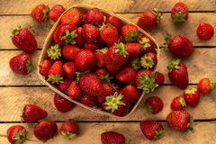Red strawberries on a wooden table. In boxes stock photography