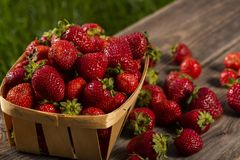 Red strawberries on a wooden table. In boxes stock photos