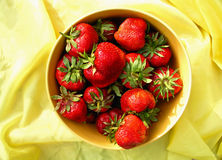 Red strawberries in yellow plate Stock Photography