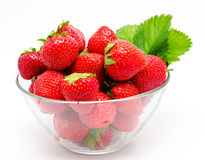 Red strawberry in the bowl. On white Stock Images