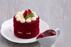 Red strawberry cake with white chocolate on wood. royalty free stock images
