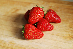 Strawberry on a chopping board Stock Image
