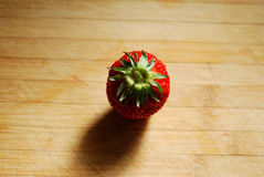Strawberry on a chopping board Stock Photography
