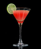 Red strawberry cocktail decorated with lime in martini Stock Image