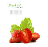 Red strawberry fruits with green leafs isolated on Royalty Free Stock Photos