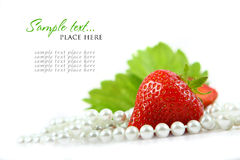 Red strawberry fruits with green leafs isolated on Royalty Free Stock Images
