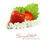Red strawberry fruits with green leafs isolated on Royalty Free Stock Photo