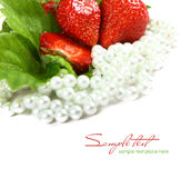 Red strawberry fruits with green leafs isolated on Royalty Free Stock Image