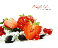 Red strawberry fruits with green leafs isolated on Stock Image