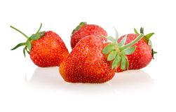 Red strawberry fruits with green leaves Stock Photo
