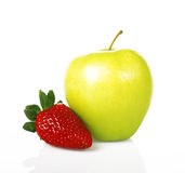 Red strawberry and green apple. On a white background stock photography