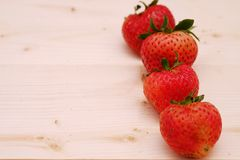 Red Strawberry Group on the Table Wood. Row Red Strawberry Group on the Table Wood Royalty Free Stock Image