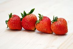 Red Strawberry Group on the Table Wood. Row Red Strawberry Group on the Table Wood Stock Photo