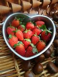 Red strawberry in heart bowl Royalty Free Stock Photo
