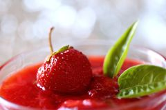 The red strawberry is a juicy and the most sumptuous fruit with a lot of vitamins. A ripe red strawberry is a pretty acidic flavor that can enslave many gourmet Stock Image