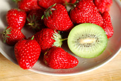 Strawberry and kiwi in plate Royalty Free Stock Image