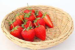 Red strawberry in a rattan basket. Royalty Free Stock Images