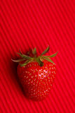 Red strawberry on red background Royalty Free Stock Photos