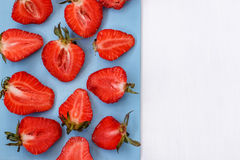 Red strawberry on white background. With blue cutting Board Stock Photos