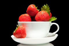Red strawberry in white cup on a black background Stock Photo