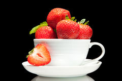 Red strawberry in white cup on a black background Stock Images