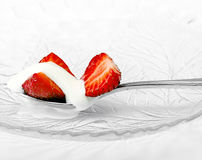 Red strawberry and white ice cream on spoon Stock Photography