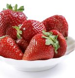 Red strawberry on a white plate Royalty Free Stock Photo