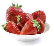 Red strawberry on a white plate Royalty Free Stock Photos