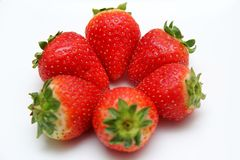 Red strawberry on white plate Royalty Free Stock Photos