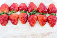 Red strawberry on wood block Royalty Free Stock Photos