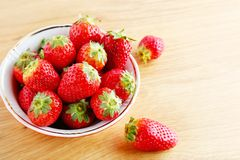Red strawberry on wooden background Royalty Free Stock Image