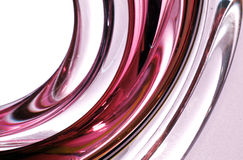 Red streaked twisted glass texture. Glass twisting with red and clear striped pattern Royalty Free Stock Photo