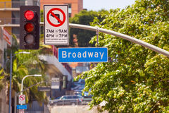 Red street light and Broadway sign on Los Angeles Stock Image