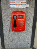 Red street telephon at public call box royalty free stock photography