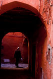 Red street. Woman back in a typical Arab street in Morocco Royalty Free Stock Photos