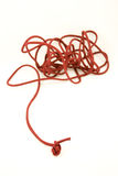 Red string. Long red string isolated on the white background royalty free stock photo
