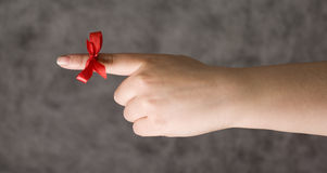 Red string around a finger Royalty Free Stock Images