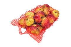 Red string bag of bright apples isolated Royalty Free Stock Image
