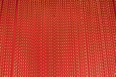 Red  string courtain. Red metallic aluminium string courtain as a background Royalty Free Stock Image