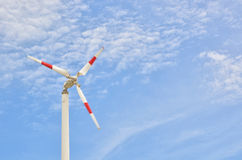 Red strip wind wheel on blue sky. It is not environmental impact Stock Photos