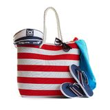 Red stripe beach bag and other accessories Royalty Free Stock Images